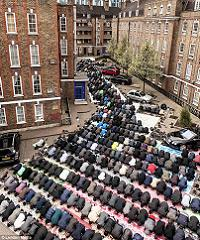 A study in devotion: The tiny mosque on the Brune Street Estate, Spitalfields, holds only 100 people, so the local Bangladeshi community throng the street for Friday midday prayers