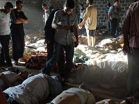 A handout image released by the Syrian opposition's Shaam News Network shows people inspecting bodies of children and adults laying on the ground as Syrian rebels claim they were killed in a toxic gas attack by pro-government forces in eastern Ghouta, on the outskirts of Damascus on August 21, 2013.