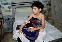 A boy, affected by what activists say is nerve gas, is treated at a hospital in the Duma neighbourhood of Damascus August 21, 2013.