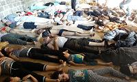 A handout image released by the Syrian opposition's Shaam News Network shows bodies of children and adults laying on the ground as Syrian rebels claim they were killed in a toxic gas attack by pro-government forces in eastern Ghouta, on the outskirts of Damascus on August 21, 2013.