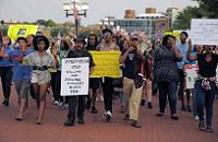 Crowd protesting police brutality led by a Muslim. Photo Courtesy Baltimore Sun